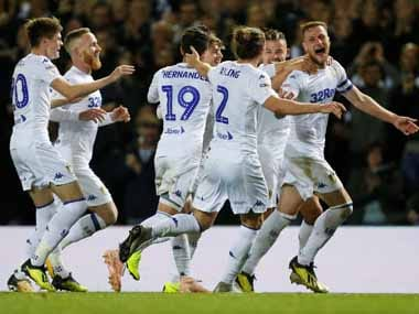 Leeds United's Liam Cooper celebrates scoring their second goal with team mates. Reuters