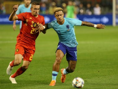 Netherlands' Memphis Depay in action with Belgium's Timothy Castagne. Reuters