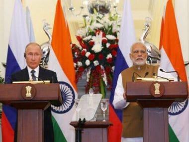Russia president Vladimir Putin and Prime Minister Narendra Modi at the summit. Twitter/MEAIndia