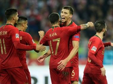 Portugal's Rafa, Ruben Dias and team mates celebrate their second goal. Reuters