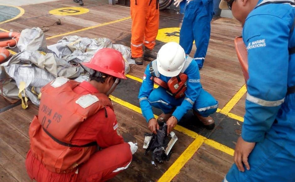 Workers of PT Pertamina examine recovered debris of what is believed to be from the crashed Lion Air flight JT610, onboard Prabu ship. Reurers