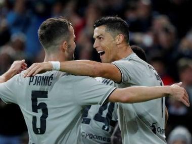 Juventus' Cristiano Ronaldo celebrates scoring their second goal with Miralem Pjanic. Reuters