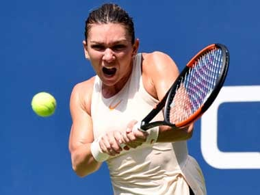 Simona Halep pleased by No 1 ranking but wary of exacerbating back injury by playing in WTA Finals