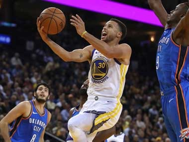 The Warriors' Steph Curry scored 32 points with nine assists and eight rebounds. AP