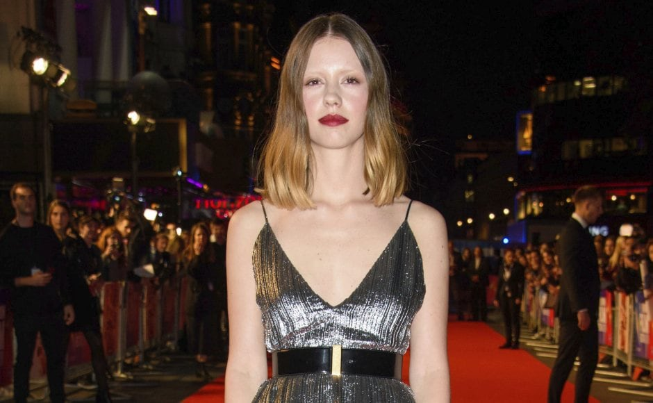 Mia Goth poses for photographers upon arrival at Suspiria's premiere at London Film Festival. Matt Crossick/PA via AP