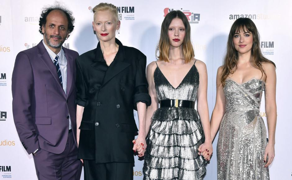From (L-R) Luca Guadagnino, Tilda Swinton, Mia Goth and Dakota Johnson pose for photographers upon arrival at the premiere of the film Suspiria as part of the BFI London Film Festival. Matt Crossick/PA via AP
