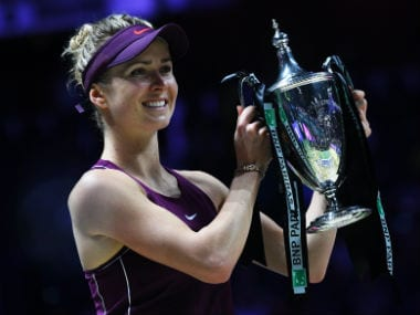 Elina Svitolina celebrates with her winning trophy after defeating Sloane Stephens in their singles final match at the WTA Finals. AFP