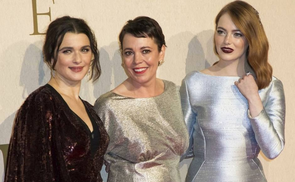 (From L-R) Rachel Weisz, Olivia Colman and Emma Stone pose for photographers upon arrival at the premiere of The Favourite showing as part of the BFI London Film Festival. Photo by Vianney Le Caer/Invision/AP