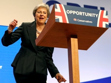 Theresa May dances to ABBAs Dancing Queen before addressing Conservative Party conference, asks party to unite over Brexit