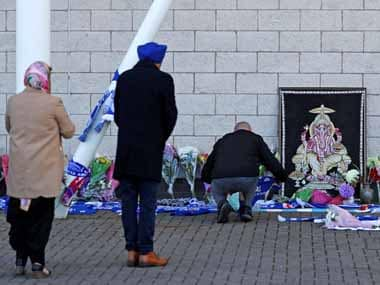 Leicester fans pay tribute to Vichai Srivaddhanaprabha outside the King Power stadium. Reuters