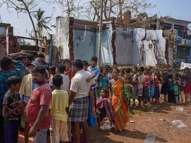 People affected by Cyclone Titli await food supplies. PTI