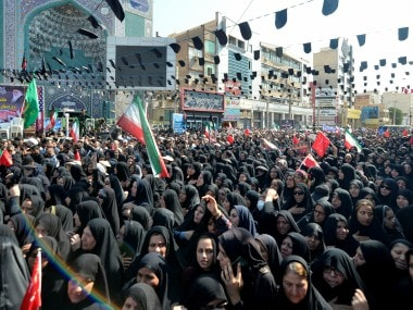 Women gather during a funeral of the victims of assault that killed 25 people, in the streets of the southwestern Iranian city of Ahvaz. AP