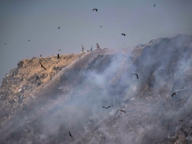 Smoke rises after a fire broke out at Bhalswa landfill site in New Delhi on Monday. PTI