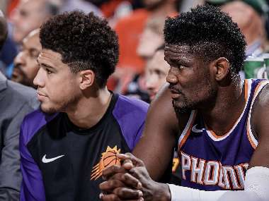 Phoenix Suns' Deandre Ayton and Devin Booker during a preseason game. Image courtesy: Twitter @Suns