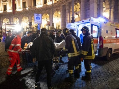 """Firefighters evacuate a person who was wounded after an escalator at the """"Repubblica"""" subway station in Rome. AP"""