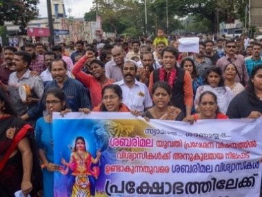 People protesting against the Supreme Court verdict on the Sabarimala temple. PTI