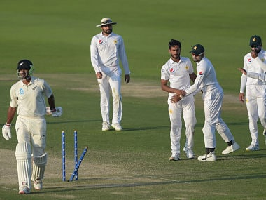 Pakistani bowler Hasan Ali (C) celebrates with teammates after taking the wicket of New Zealand batsman Ish Sodhi (L) during the third day of the first Test cricket match between Pakistan and New Zealand at the Sheikh Zayed International Cricket Stadium in Abu Dhabi on November 18, 2018. - Pakistan need 176 runs to win the first Test after New Zealand were dismissed for 249 in their second innings on the third day in Abu Dhabi on November 18. (Photo by AAMIR QURESHI / AFP)