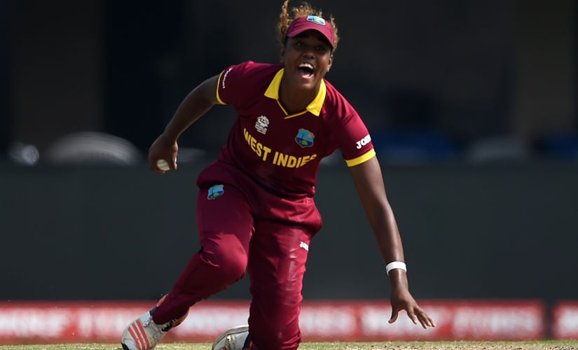 West Indies's Hayley Matthews celebrates after taking a catch off her own bowling to dismiss Australia's Alyssa Healy during the World T20 cricket tournament women's final match between Australia and West Indies at The Eden Gardens Cricket Stadium in Kolkata on April 3, 2016. (Photo by INDRANIL MUKHERJEE / AFP)
