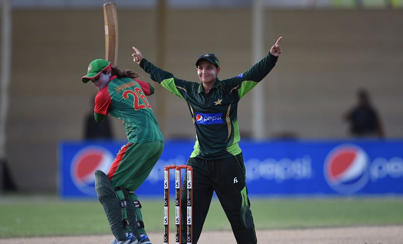 Pakistani cricketer Anam Amin (R) celebrates after taking wicket of Bangladeshi cricketer Jahanara Alam (L) during the first women's One Day International (ODI) cricket match between Pakistan and Bangladesh at the Southend Club in Karachi on October 4, 2015. AFP PHOTO / Asif HASSAN (Photo by ASIF HASSAN / AFP)
