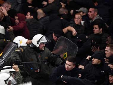 Fans clash with police at the stadium. AFP