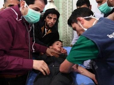 Medical staff treats a boy following a chemical attack al-Khalidiya town, in Aleppo. AP