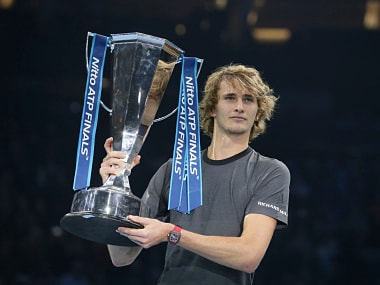 Alexander Zverev of Germany holds the trophy after defeating Novak Djokovic of Serbia in their ATP World Tour Finals singles final tennis match at the O2 Arena in London, Sunday Nov. 18, 2018. (AP Photo/Tim Ireland)