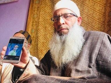 Ashraf Kutay shows image of his son Huzaif, who was executed by militants. Image courtesy: Sameer Yasir
