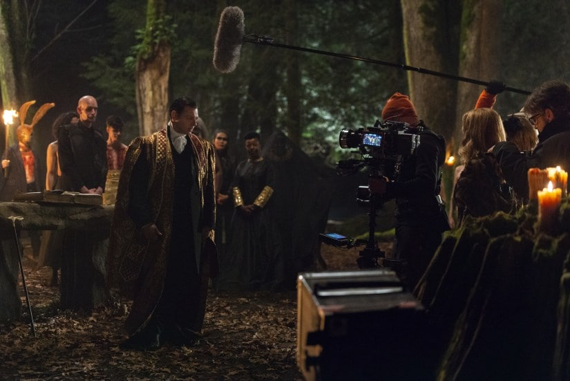 A behind-the-scenes still from Sabrina's dark baptism in the woods. Netflix