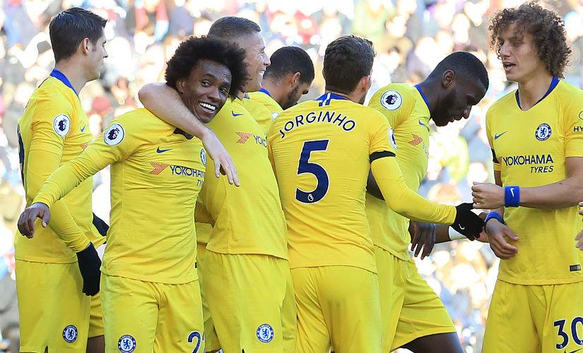 Chelsea players celebrate after scoring against Burnleylast month. AFP