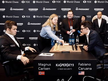 Ellisiv Reppen making the ceremonial first move for Carlsen (left) at the start of Game 4. Image: Nadia Panteleeva / World Chess