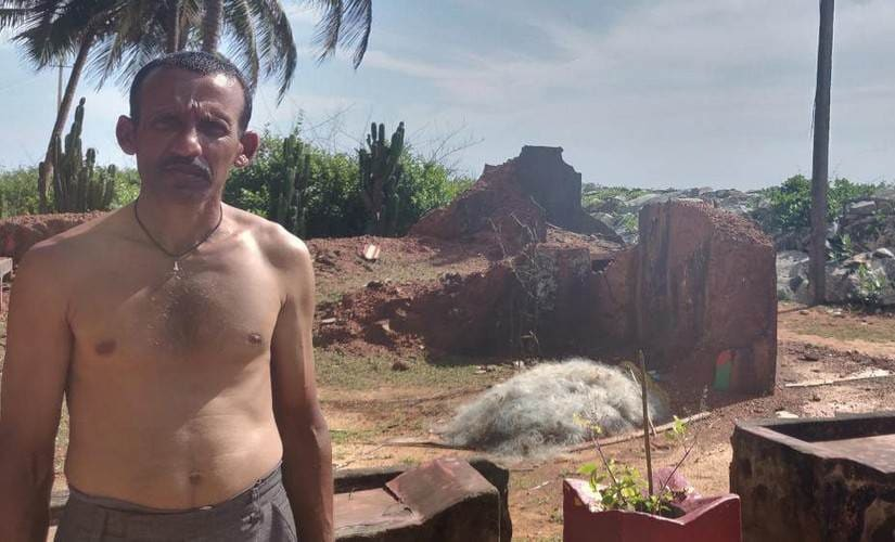 Budhwant Karvi, 40, visits the remains of his old home in Pavinarkurve village in Honnavar, Karnataka, on festivals and special occasions. To stop the erosion, the government constructed a stone wall, but it wasn't enough to hold back the waves. Image courtesy: Disha Shetty
