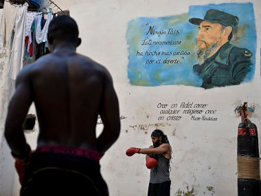 Cubans attend a training session at a boxing gym in Havana, on November 12, 2018. - The International Olympic Comettee (IOC) who threated to exclude Boxing from the Olympic Games after Rio 2016 scandal -in which 36 officials and boxing referees were suspended amid rumours of rigged combats- will decide if it does so at the end of November, the result of this decision could be a knock out for this sport's leading exponent, Cuba. (Photo by YAMIL LAGE / AFP)