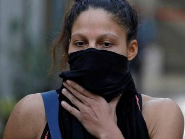 Colombian boxer Dayana Cordero covers her face with a cloth after her practice session ahead of AIBA Women's World Boxing Championships at Indira Gandhi Indoor Stadium in New Delhi, India, November 12, 2018. Picture taken November 12, 2018. REUTERS/Anushree Fadnavis - RC11D4879590