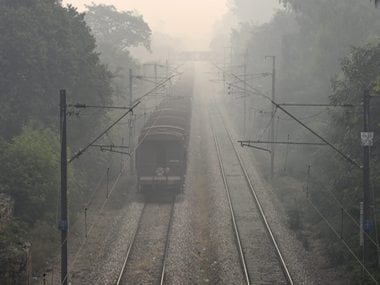 A train runs through the thick haze in Delhi. PTI