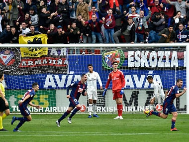 Deportivo SD Eibar's Sergi Enrich (right) celebrates after scoring his team's second goal against Real Madrid. AP Photo