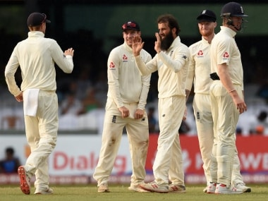 England's Moeen Ali celebrates fall of a Sri Lankan wicket with his teammates. AFP