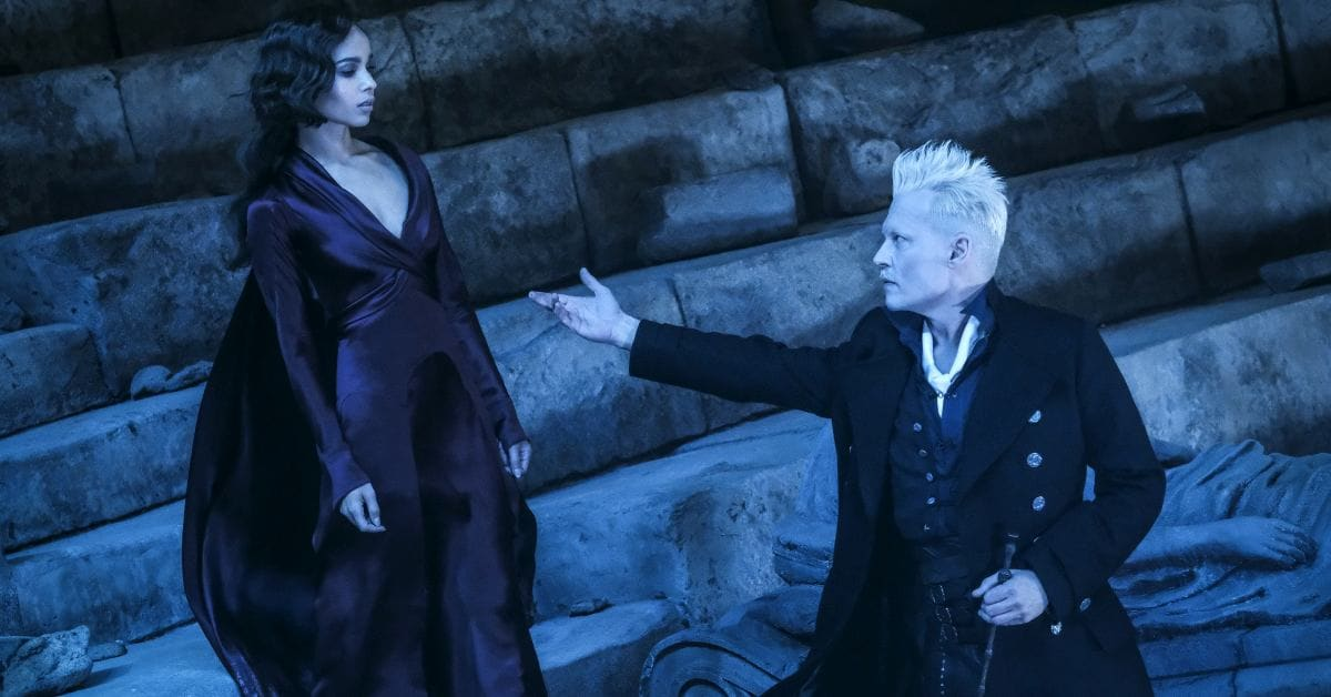"This image released by Warner Bros. Pictures shows Zoe Kravitz, left and Johnny Depp in a scene from ""Fantastic Beasts: The Crimes of Grindelwald."" (Jaap Buitendijk/Warner Bros. Pictures via AP)"
