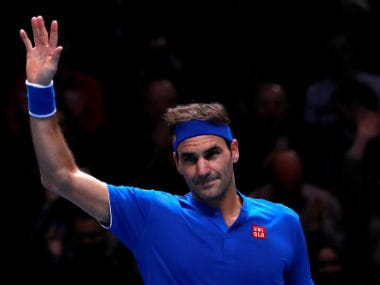 Switzerland's Roger Federer celebrates winning his group stage match against Austria's Dominic Thiem. Reuters