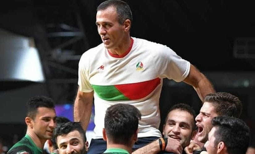 Iran players lift coach Gholamreza Mazandarani on their shoulders after beating South Korea in Asian Games final in Jakarta. Image Courtesy: Gholamreza Mazandarani