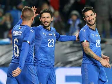 Italy's Matteo Politano celebrates scoring their first goal with Marco Verratti and Stefano Sens. Reuters