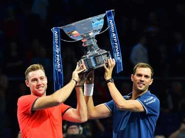 Americans Jack Sock Mike Bryan pose for a photograph with their winner's trophy after the men's doubles final on day eight at the ATP World Tour Finals. AFP