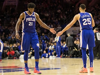 Nov 19, 2018; Philadelphia, PA, USA; Philadelphia 76ers center Joel Embiid (21) and guard Ben Simmons (25) slap hands after a score against the Phoenix Suns during the second quarter at Wells Fargo Center. Mandatory Credit: Bill Streicher-USA TODAY Sports - 11699878