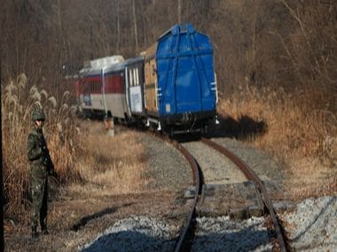 A train carrying South Korean engineers and officials crosses into the North. AFP