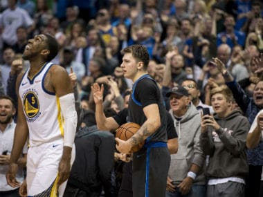 Golden State Warriors forward Kevon Looney (5) checks the scoreboard as the Dallas Mavericks fans react to forward Luka Doncic (77) making a rebound to seal the win over the Warriors at the American Airlines Center. Reuters