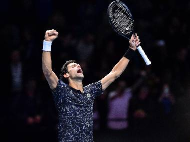 Novak Djokovic celebrates after beating John Isner at the ATP World Tour Finals. AFP