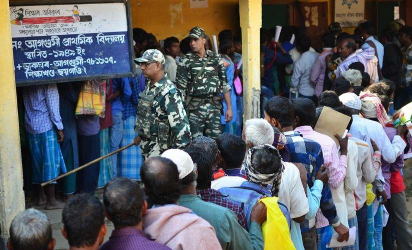 People stand in line to check their names on the first draft of NRC at Gumi village of Kamrup district in Assam. AFP