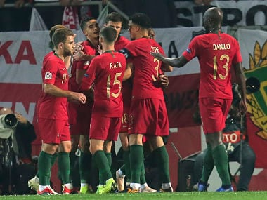 Portugal players celebrate after their goal against Poland. AP Photo