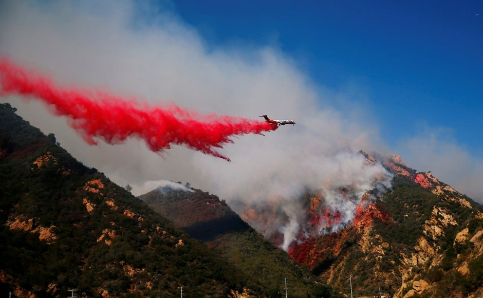Aircraft were deployed to drop flame retardant as firefighters battled the wildfire on ground. Reuters