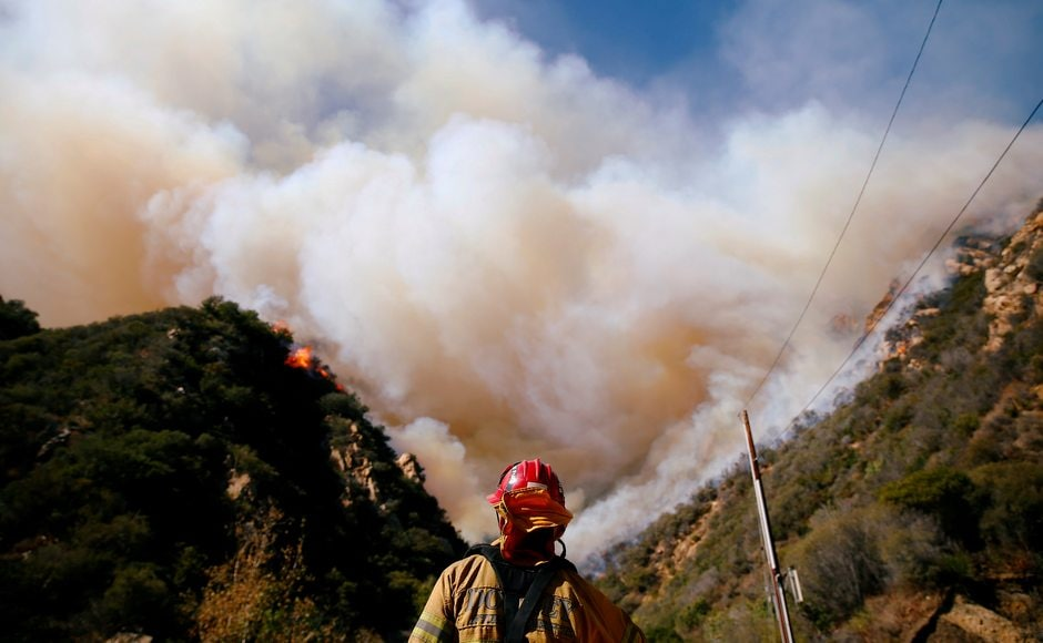 At the southern end of the state, firefighters battled the Woolsey Fire which left devastation in its wake. Reuters