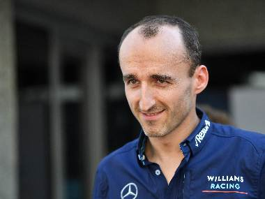 Robert Kubica talks to journalists ahead of the Abu Dhabi Grand Prix. AFP